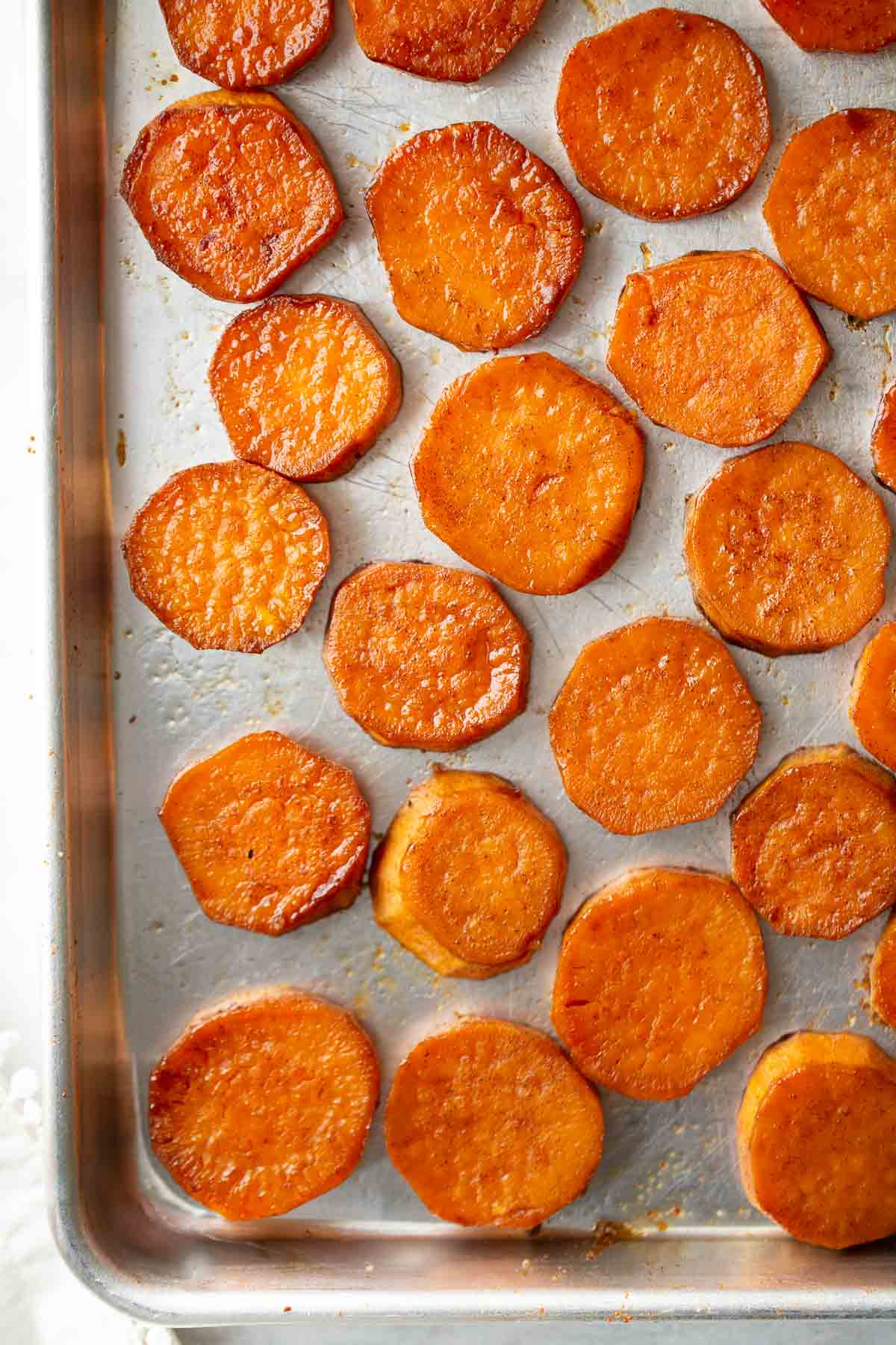 roasted sweet potatoes cut in circles on pan