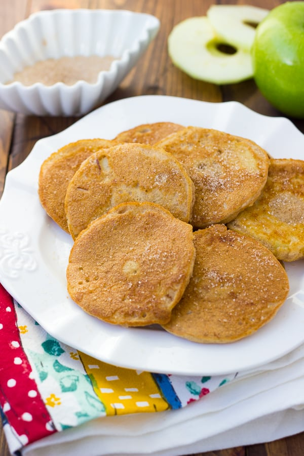 Grain-Free Apple Ring Pancakes! Protein-packed pancakes filled with a slightly softened apple ring and dusted with cinnamon sugar.