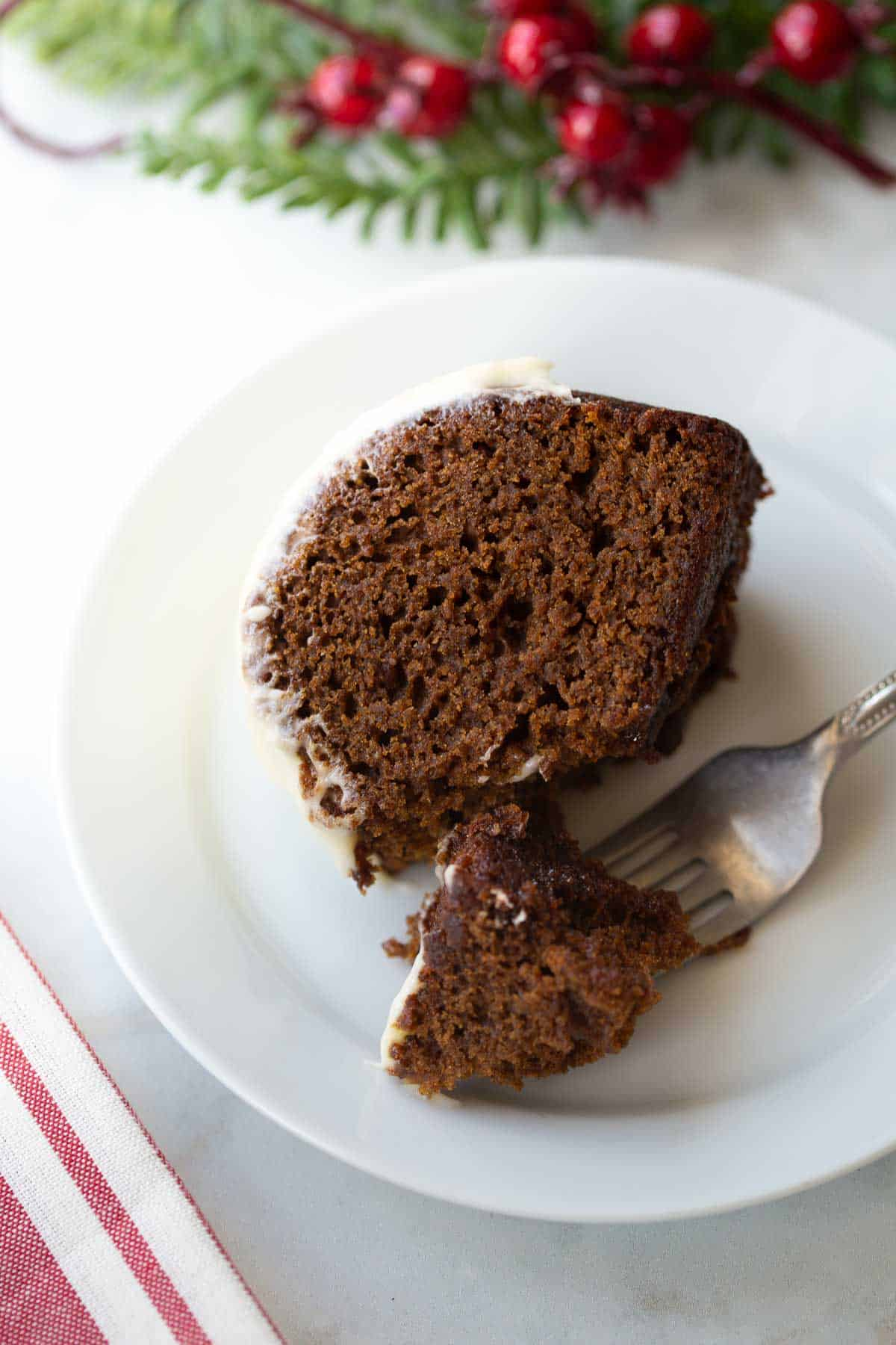 slice of gluten-free gingerbread on white plate