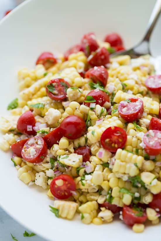 Summer corn salad with tomatoes and feta. So simple, but completely addicting. A naturally gluten-free side and great way to enjoy fresh corn and tomatoes!