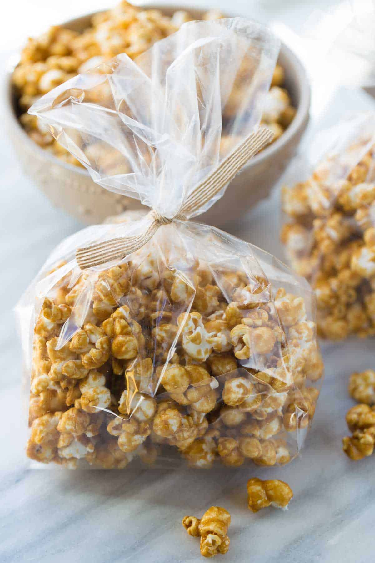 caramel corn in bag with ribbon for holiday gift