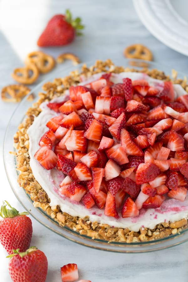 Vegan Strawberry Ice Cream Pretzel Pie! Gluten-free pretzel crust with an easy, homemade dairy-free cashew ice cream and fresh strawberries!