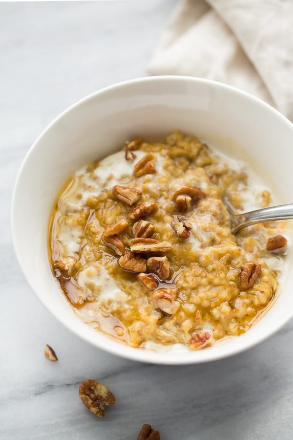 Instant Pot Creamy Pumpkin Maple Oatmeal! No-stir, perfectly soft oats cooked for 10 minutes in the pressure cooker. Lightly sweet with all the flavors of fall! {Dairy-Free, Gluten-Free}