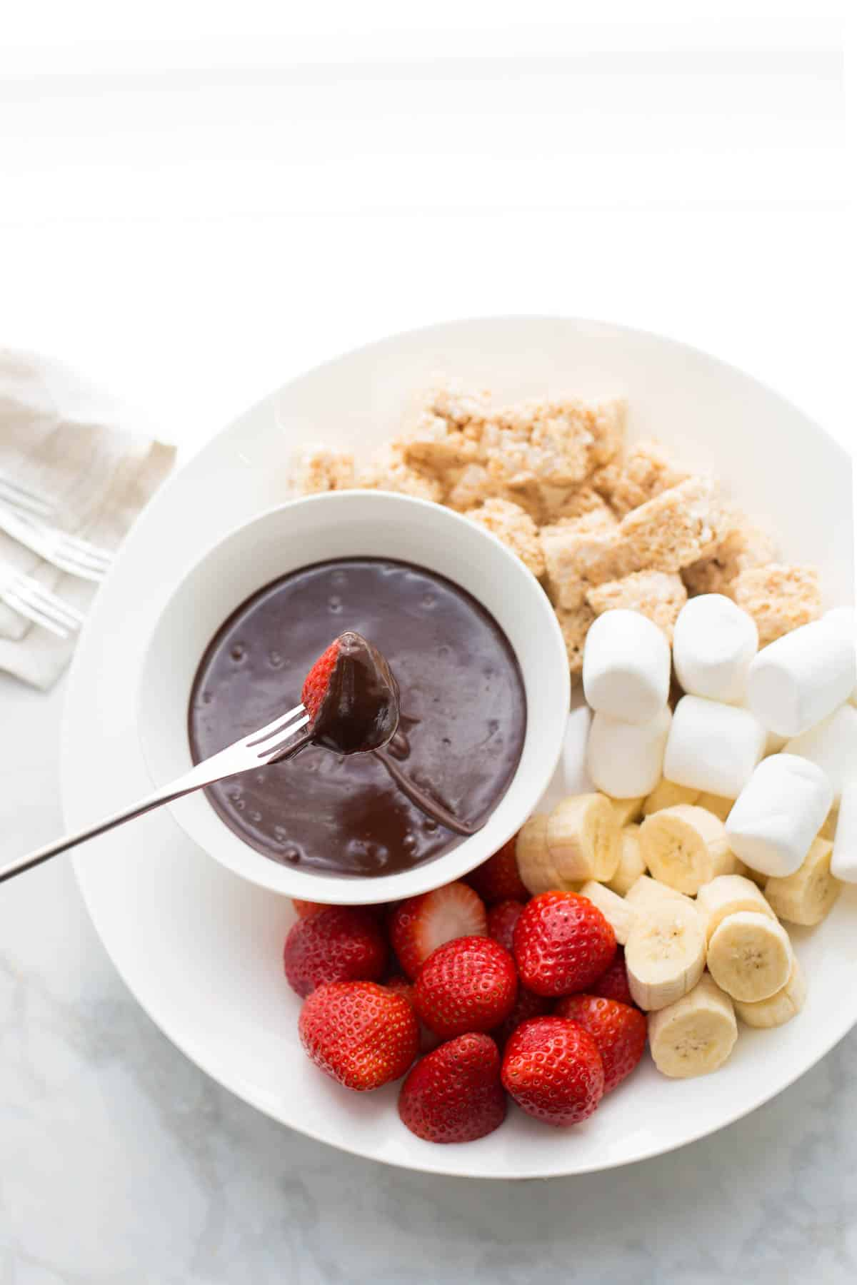 overhead shot of chocolate fondue being dipped