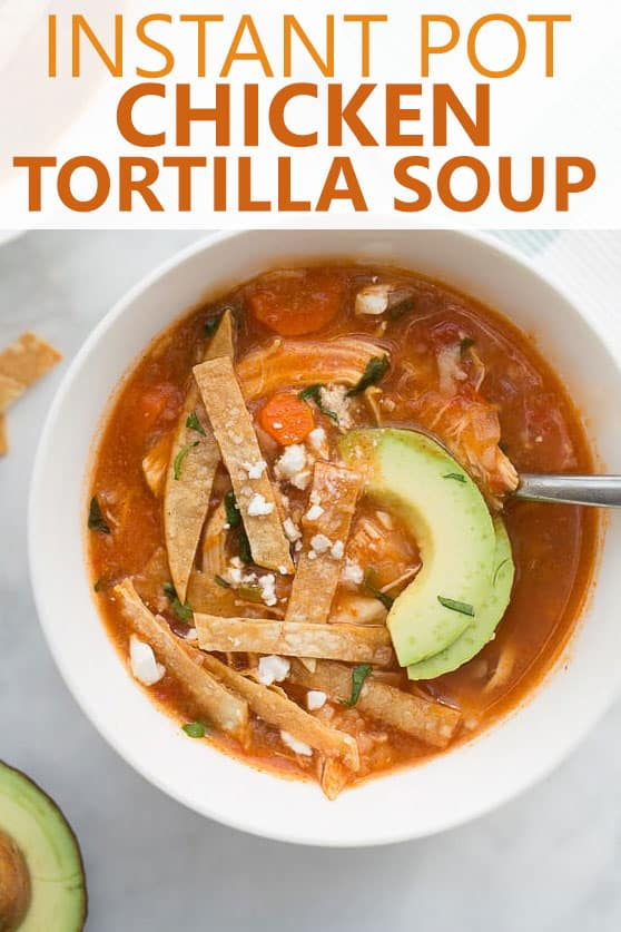 up close image of instant pot chicken tortilla soup in white bowl