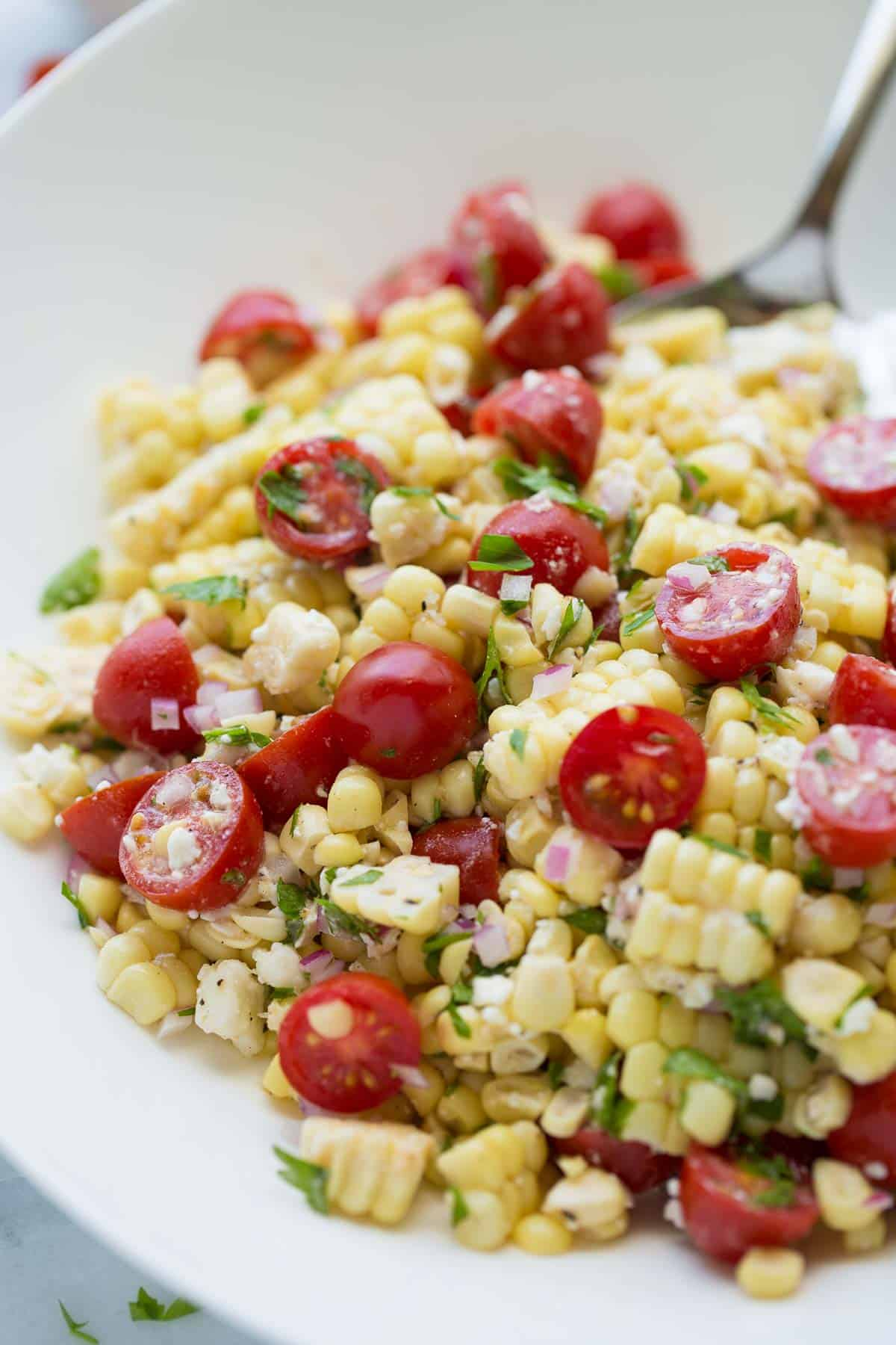 up close shot of summer corn salad in bowl